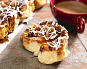 Cinnamon Sticky Bun with a Cup of Coffee
