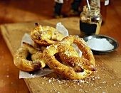 Soft Pretzles with a Dish of Salt and a Crock of Mustard