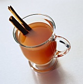 Glass Mug of Apple Cider with Cinnamon Sticks