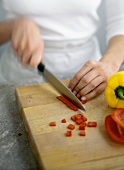 Slicing Red Peppers on a Cutting Board