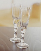 Two Champagne Flutes, Partially Filled