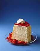 Angel Food Cake with Sliced Strawberries and Whipped Cream