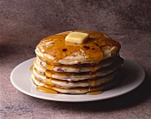 Five Blueberry Pancakes with Syrup and Butter