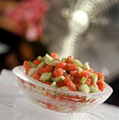 Melon and cucumber relish in chilled bowl