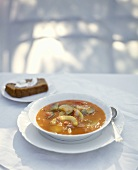 Vegetable soup with pumpkin, tomatoes & courgettes, bread