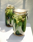 Pickled gherkins in pickling jars