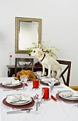 Labrador Standing with Two Front Paws on Christmas Table