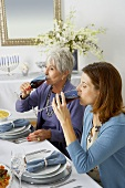 Two Women Drinking Red Wine at Hanukkah Diner Table