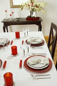 Table Set with Red Candles for Christmas Dinner