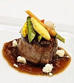 Fillet Mignon Topped with Baby Roasted Vegetables and Blue Cheese in a Balsamic Glaze