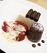 Two chocolate desserts and one strawberry dessert on plate