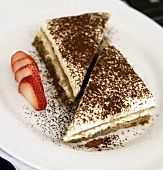 Two Pieces of Tiramisu on a Plate with Sliced Strawberry