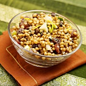 A bowl of pearl barley with dried fruit