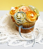 A Single Cupcake Decorated with Frosting Rose Buds