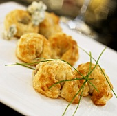 Appetizer Platter of Olive Stuffed Puff Pastry with Chive Garnish