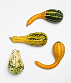 Four Assorted Gourds on a White Background