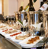 Many Platters of Appetizers with Bottles of Wine in Ice Buckets