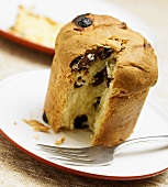 Panettone on a Plate with Slice Removed