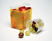 Strawberries and Grapes in Storage Containers