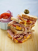 Croque Monsieurs with Red Onion and Tomato Stacked, Toothpick with Olive