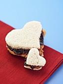 Two Heart Shaped Peanut Butter and Jelly Sandwich, One Big and One Small