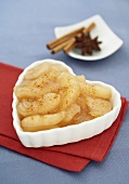 Heart Shaped Ramekin Filled with Apple Pie Filling, Cinnamon and Star Anise