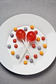 Two Lollipops with Candies on a White Plate