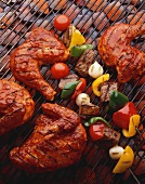 Barbecue Chicken and Kabobs on the Grill Over Hot Coals