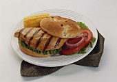 Grilled Chicken Breast Sandwich with Corn on the Cob