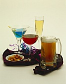 An Assortment of Alcoholic Beverages with a Bowl of Mixed Nuts