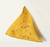A Single Yellow Corn Tortilla Chip on a White Background