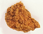Close Up of a Crispy Fried Chicken Breast on a White Background