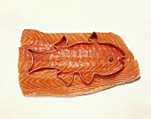 Salmon Fillet with a Fish Cookie Cutter; White Background