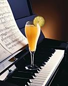 Orange Juice Cocktail on a Piano