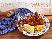 Pecan Fried Chicken on a Plate with Mashed Potatoes and Corn and Lima Bean Salad