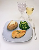 Dinner of Chicken Breast with Baked Potato and Broccoli; Water and White Wine