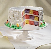 Colorful Checkered Easter Cake with White Frosting, Slice Removed