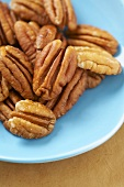 Many Whole Pecans on a Plate