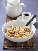 A Bowl of Shredded Wheat with Coffee