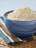 Whole Wheat Flour in a Blue Bowl