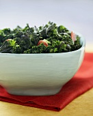 Bowl of Cooked Kale with Bacon