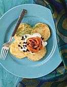 Serving of Blini Topped with Salmon, Caviar and Sour Cream