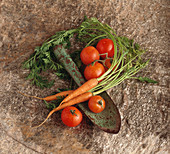 Rustic Garden Shovel with Fresh Carrots and Tomatoes