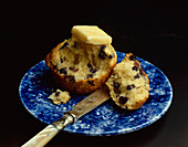A Pat of Butter Melting on a Blueberry Muffin