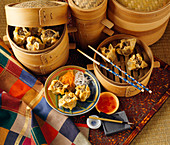 Steamed Chinese Dumplings with Bamboo Steamers and Dipping Sauce