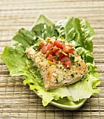 Salmon Topped with Tomato and Orange Salsa on a Lettuce Leaf