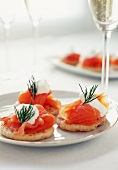 Smoked Salmon Blini on a Plate; Glasses of Champagne