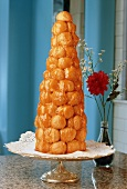 Croquembouche on a Pedestal Dish, Flowers in a Vase