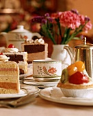 Tea Service with Slices of Layered Cake and Pastries