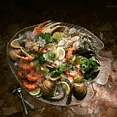 Assorted Shellfish Over Ice on a Glass Fish Shaped Platter
